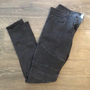 Motorcycle stacked black skinny jeans